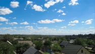 Clouds In The Sky Moving Over The Houses In The City Stock Footage
