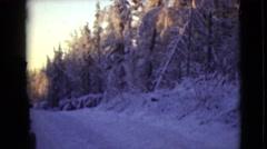 1946: a snowy area is seen with a broken down car ALASKA Stock Footage