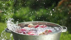 Apple splashing into water in slowmotion Stock Footage