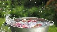 Apple splashing into water in slowmotion Stock Footage