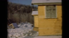 1946: one or two wooden houses viewed in large remote snowy pine forest ALASKA Stock Footage