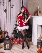 Beautiful woman near the fireplace in winter house. selebrating christmas, st Stock Photos