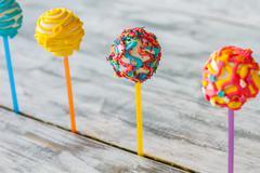 Bright colored cake lollipops. Stock Photos