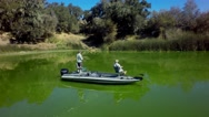 Aerial view of fishermen on a boat fishing in a lake Stock Footage