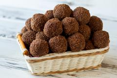 Brown sweets in a basket. Stock Photos