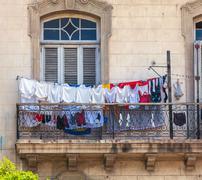 Fresh laundry on the balcony of old home, Havana Stock Photos