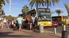 FRANCE NICE- A crowd of tourists near the shuttle yellow bus in France Stock Footage