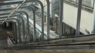 Business people talking on escalator Stock Footage
