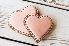 Pair of heart-shaped biscuits. Stock Photos