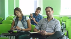 A group of students listening to a lecture in class Stock Footage
