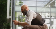 4k, Shot of a businessman using a mobile phone Stock Footage