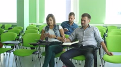 Students listen to teachers lecture and ask questions Stock Footage