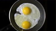 Cooking eggs in a frying pan. Time Lapse. Top view. Stock Footage