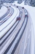 Snowy highway at dusk with light streaks of cars, British Columbia, Canada. Stock Photos