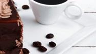 Breakfast hot coffee mug and cream chocolate layer cake Stock Footage
