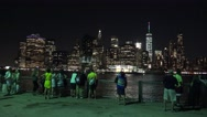 Visitors look towards Downtown Manhattan from Brooklyn, New York. Stock Footage