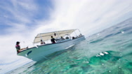 Dive boat to reef Stock Footage