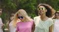 Beautiful female friends hugging and dancing, sharing selfie in social network Footage