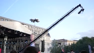 Camera crane shooting concert video above a people crowd spectators outdoors Stock Footage