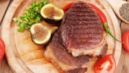 Grilled beefsteak served with hot cayenne peppers green stuff Stock Footage