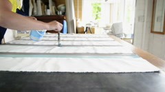 Woman painting on textile Stock Footage
