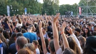 Huge teenager people crowd stay by concert stage waiting for concert performance Stock Footage