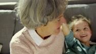 Grandmother and granddaughter playing Stock Footage