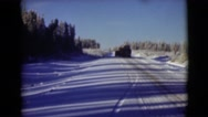 1946: snowsweaper fixing the road in the middle of the country. ALASKA Stock Footage