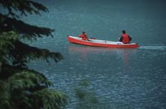 Father & son in red canoe on Emerald Lake, British Columbia, Canada. Stock Photos