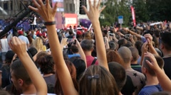 Concert people crowd teenager fans stay enjoy music performance raise hands up Stock Footage