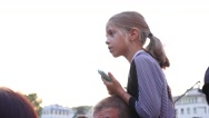 Little blonde girl sit on shoulders of father during music concert open air Stock Footage