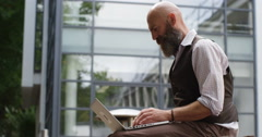 4k, Workaholic businessman in a suit working on a laptop Stock Footage