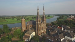 Aerial circling big church in small town,Cuijk,Netherlands Stock Footage