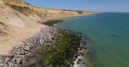 Aerial view of coast erosion Stock Footage