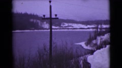 1946: a winter scene of a lake and a hill in the distance with snow on  Stock Footage