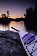 Kayak and Yachts at dusk in Desolation Sound Marine Park, Curme Island, British Stock Photos