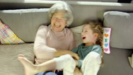 Grandmother playing with granddaughter Stock Footage