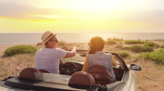 Cute Young Couple Man And Woman Arriving At Beach In Convertible Car Parking At Stock Footage
