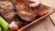 Beef pork meat grilled ribs on wood Stock Footage