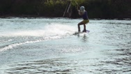 Blonde rides on a wakeboard, slow motion Stock Footage