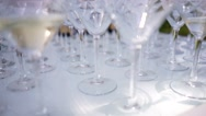 Many glasses of champagne on the table covered with a white table cloth Stock Footage