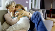 Grandmother hugging granddaughter Stock Footage