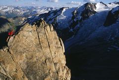 A women on the summit ridge of Eastpost Spire, Bugaboo Provincial Park, British Stock Photos