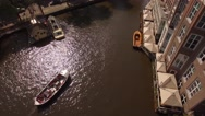 Aerial. Tour boats on water channel in Amsterdam. 4K Stock Footage