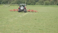 Farmer in tractor turning hay,Oudekerk,Netherlands Stock Footage