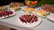 Catering. Decorated table, on skewers - grapes, brie cheese Stock Footage