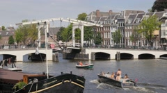 Historical drawbridge and canal houses on Amstel river,Amsterdam,Netherlands Stock Footage