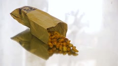 Cashew nuts lying on a mirror table, close-up Stock Footage