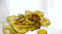 Dried fruits from apples fall on a mirror table, close-up Stock Footage