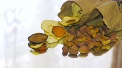 Dried fruits from apples, almonds and cashews are on the mirror table, close-up Stock Footage